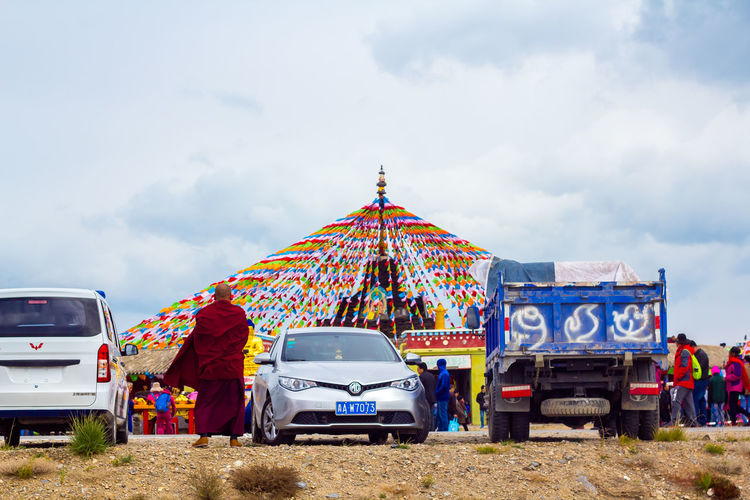 Tibetan Buddhism Car Cloud - Sky Day Land Vehicle Mode Of Transport Nature Outdoors Real People Sky Tibet Tibetan Prayer Flags Transportation