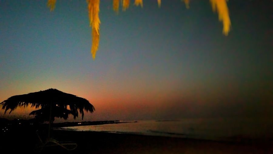Sea Sunset Beach Outdoors Nature Silhouette Beauty In Nature Scenics No People Tranquility Water Sky Tree Day This Is Egypt ❤ Photogtaphyinmotion EyeEm Nature Lover EyeEm Best Shots The Land Of Beauty Sokhna , Egypt Travel Destinations Landscape Mountain Tranquil Scene Tranquility