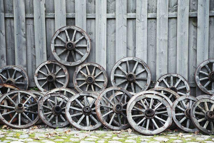 Gray Wooden Tires By Wall