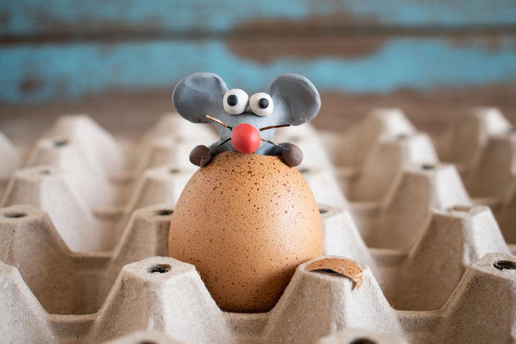 Rat from plasticine, cartoon style.rats come out from chicken eggs.