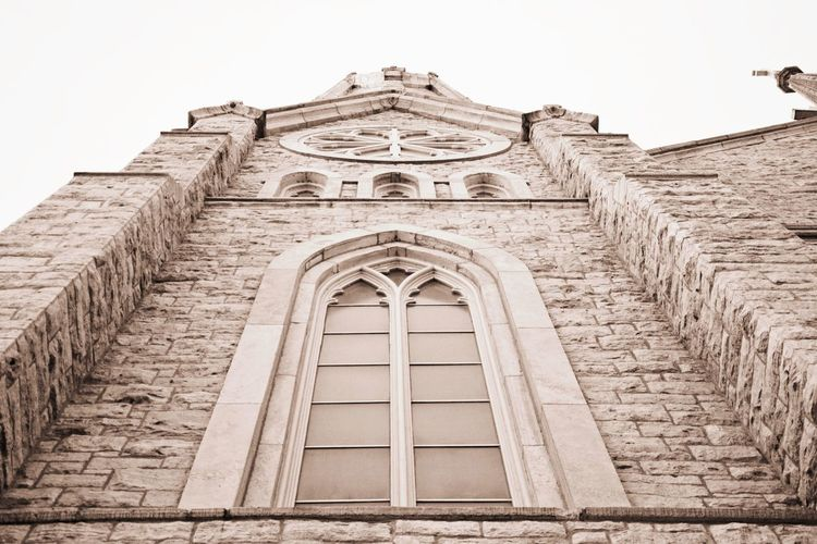 Low angle view of St. Mary's Cathedral. Sepia Look Historic Building Catholic Church Architecture Built Structure Low Angle View Building Exterior History Arch EyeEmNewHere Outdoors Day Place Of Worship Religion No People Spirituality Façade Clear Sky Sky Travel Destinations
