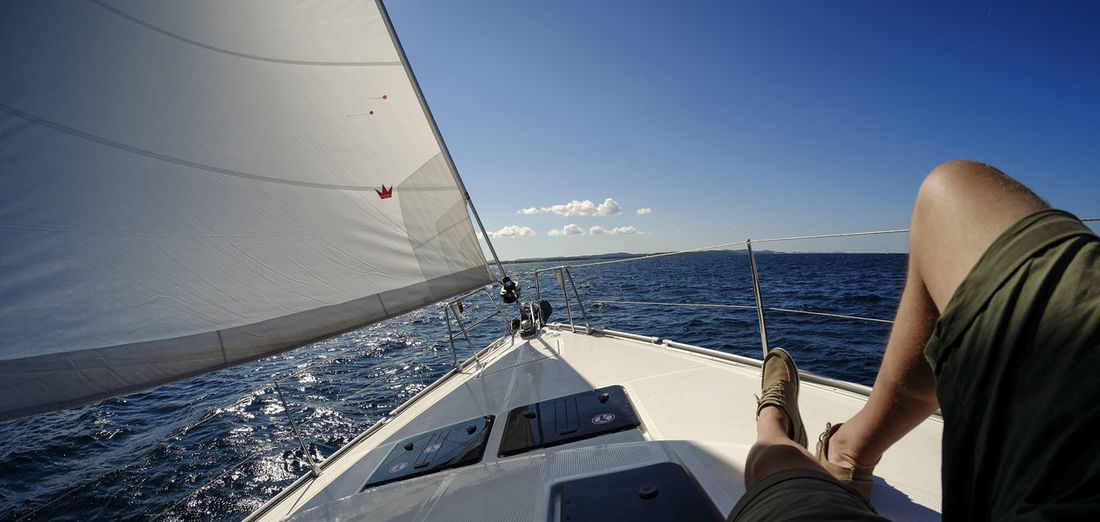 Lazysail Bavaria Yacht Horizontal Lazy Sail Lonely Man Lying On Bench Under Tree On Board On Board Boat Relaxing On Board Sailing