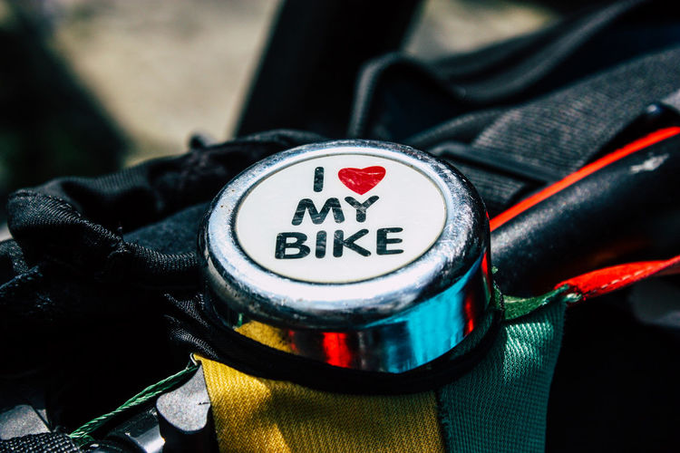 High angle view of text on bicycle bell