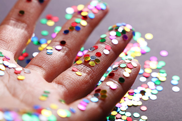 Close-up of hand with colorful sequin