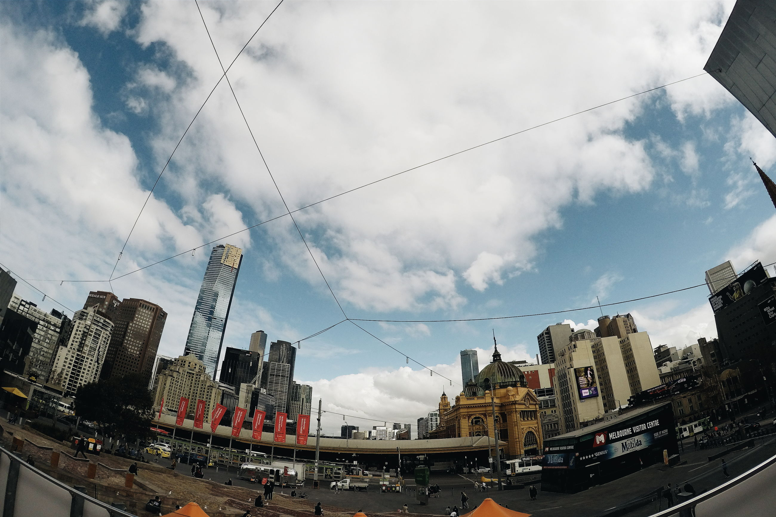 sky, transportation, building exterior, cloud - sky, built structure, architecture, city, cloud, low angle view, cable, power line, cloudy, day, city life, no people, tall - high, semi-truck