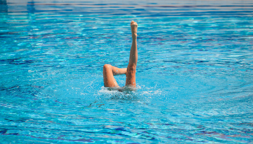 Synchronized swimmer's legs stretched out in the air. Grace Legs In The Pool Water Sport Activity Beauty Blue Water Coreography Endurance Feet Legs Legs In The Air Motion Movement Pool Position Strenght Stretched Swimmer Swimming Pool Swimming Pool Water Synchronized Swimming Water Water Ballet Water Sports Beauty Outdoors Water Surface
