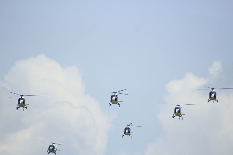 Helicopters on formation with blue sky background