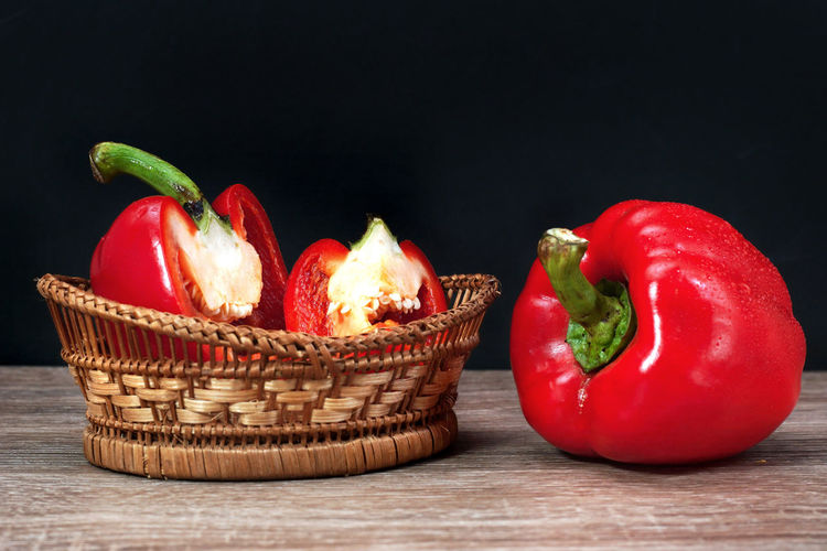 High angle view of red bell peppers in basket on table
