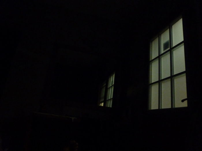 Low angle view of house window at night