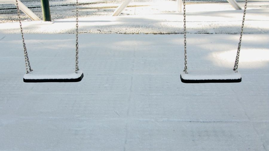 High angle view of empty swing in winter