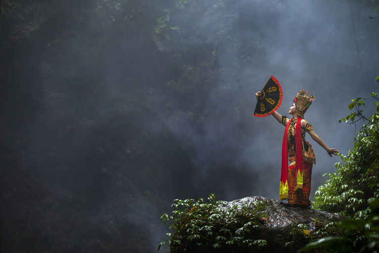 Woman in traditional clothing on mountain