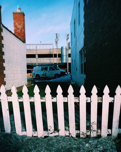Fence in the city. Architecture Building Exterior Built Structure No People City Fence White Picket Fences White Fence