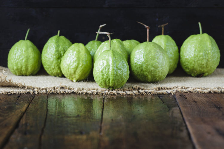 Guavas on wooden table
