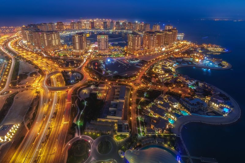 Pearl city in blue hour Blue Hour Qatarlife Qatar Doha Pearl City Illuminated Night City Cityscape Building Exterior Architecture Built Structure Lighting Equipment Nature Water City Life Building Glowing Transportation Outdoors Office Building Exterior No People Modern Sky Aerial View
