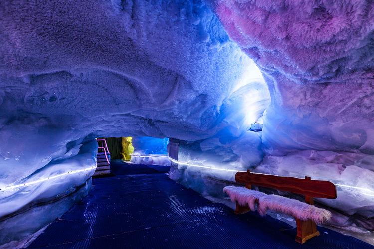 Illuminated tunnel in snow