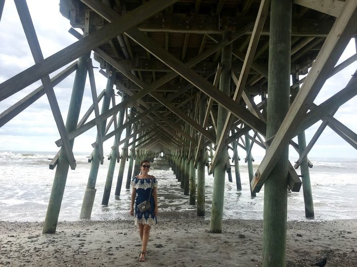 Americana Charleston Pier USA Architecture Beach Below Day Folly Beach Full Length Horizon Over Water Leisure Activity Lifestyles One Person Outdoors Real People Sand Sea Standing Underneath Vacations Walking Water Wave Young Adult