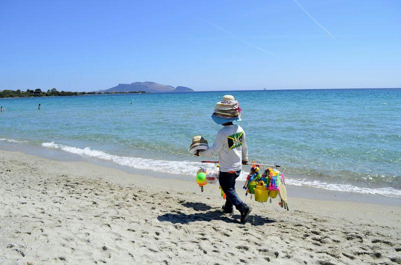Man selling toys on beach