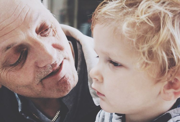 Close-up of grandfather with grandson