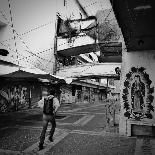 Full length of man standing in city against sky