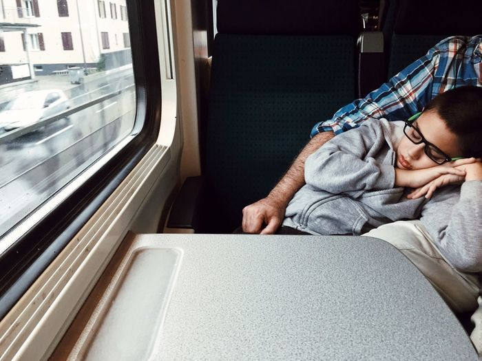 Close-Up Of Boy Sleeping On Train