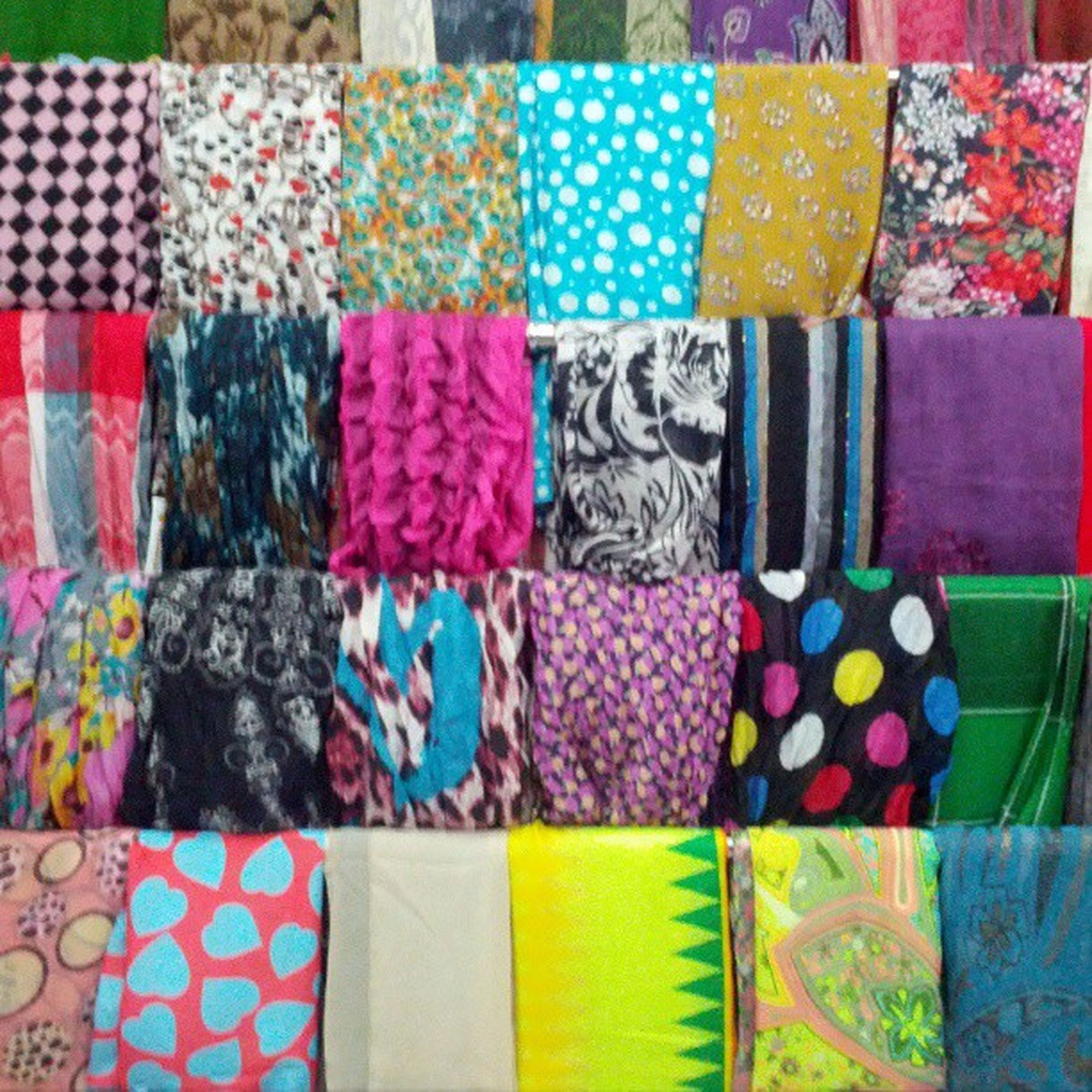 multi colored, variation, choice, colorful, indoors, large group of objects, for sale, textile, abundance, retail, in a row, still life, arrangement, fabric, full frame, collection, stack, side by side, pattern, order
