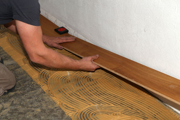 Midsection of carpenter working by wall