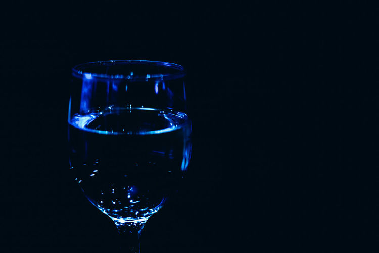 Close-up of glass of water against black background