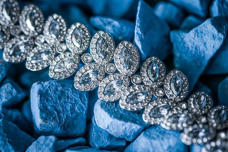 Close-up of diamond necklace on stones