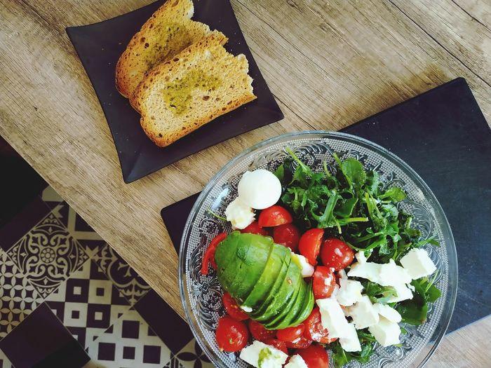 High angle view of salad served on table