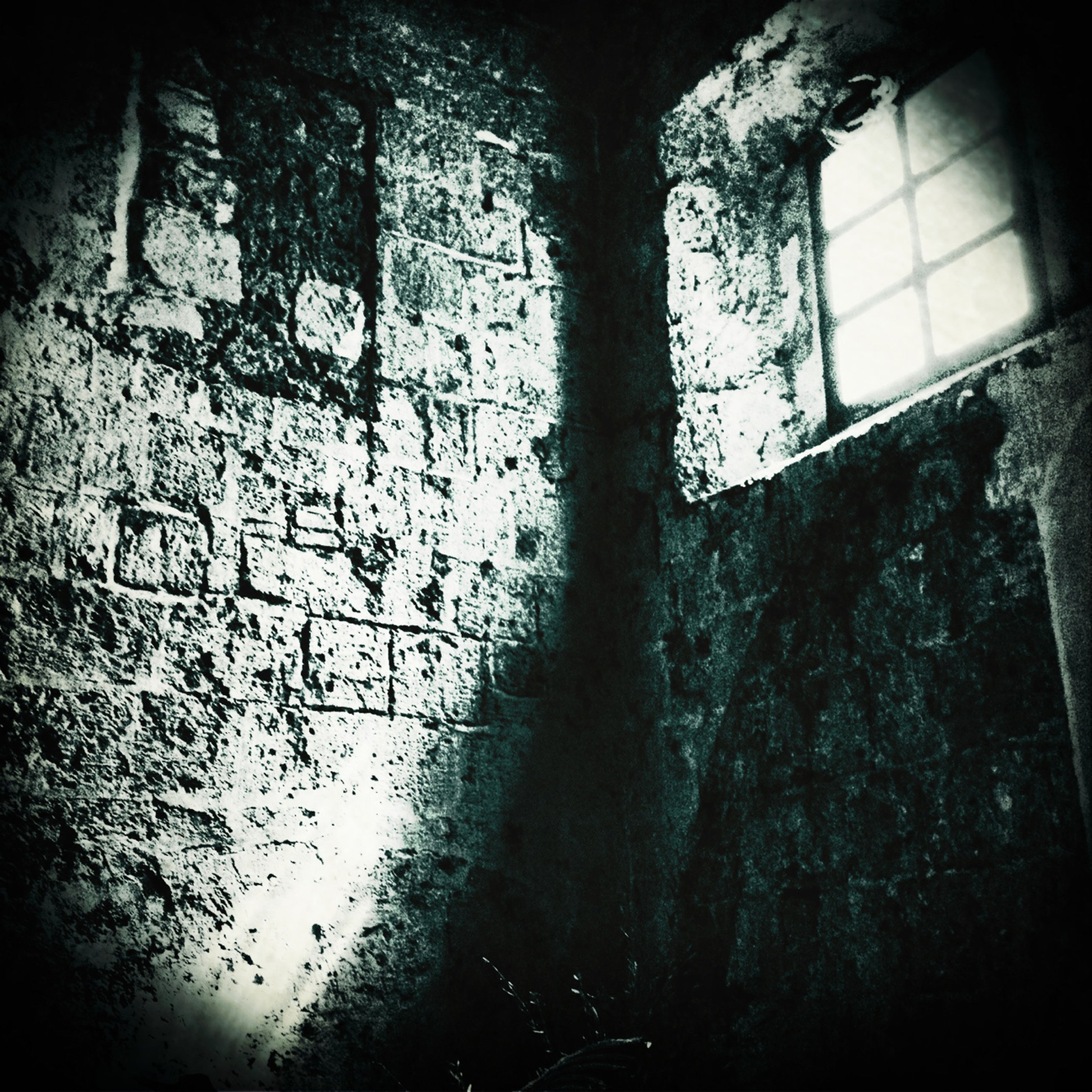 indoors, window, architecture, built structure, wall - building feature, abandoned, damaged, obsolete, shadow, wall, old, sunlight, deterioration, graffiti, run-down, silhouette, weathered, day, building, no people