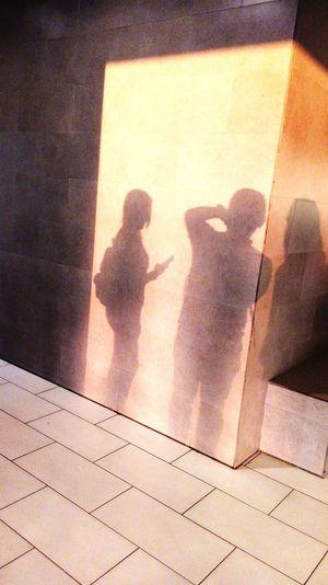 Shadow of people standing on floor