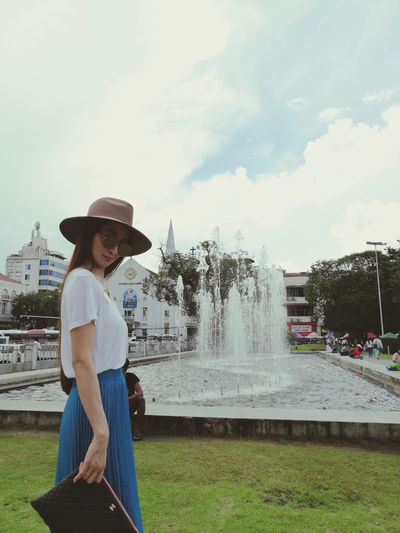 #photobytaton #EyeEmNewHere #Myanmar #yangon Water Spraying Women Sun Hat Standing Irrigation Equipment Motion Summer Young Women Cowboy Hat