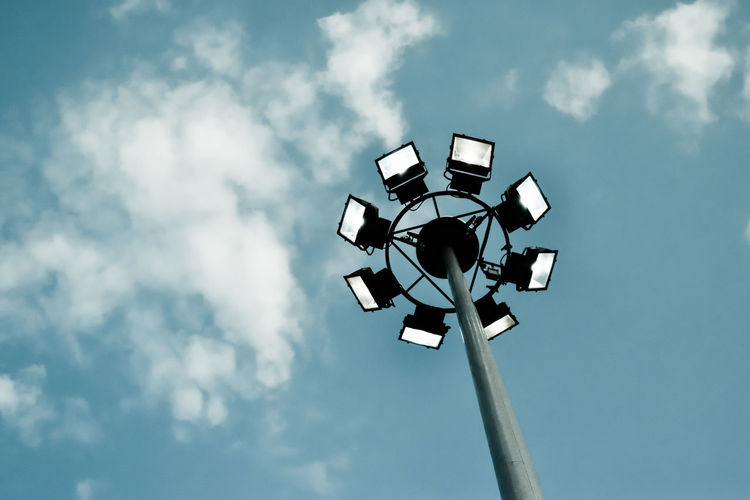 Low Angle View Of Illuminated Floodlights Against Sky