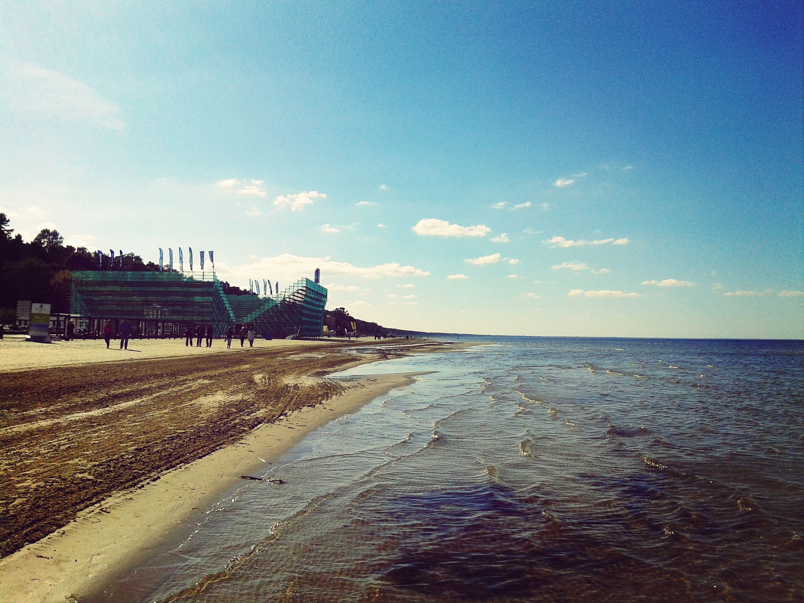 sea, water, horizon over water, sky, beach, built structure, architecture, tranquil scene, building exterior, tranquility, scenics, shore, blue, beauty in nature, nature, sand, pier, cloud, waterfront, idyllic