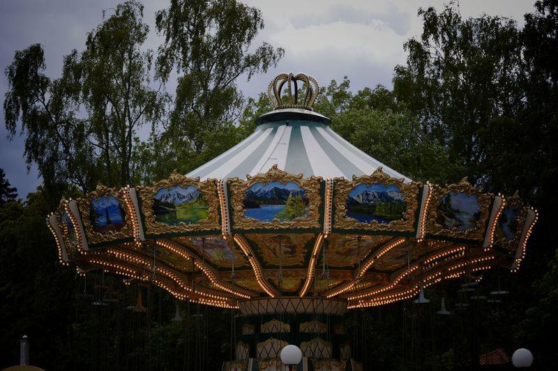 Ferris wheel in park against sky