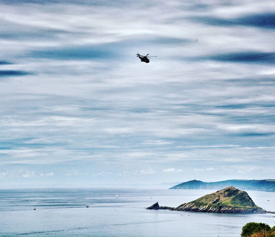 Flying Sky Cloud - Sky Sea Airplane Mid-air Nature Horizon Over Water Outdoors Transportation Air Vehicle Day Beach Scenics Low Angle View No People Water Beauty In Nature Helicopter