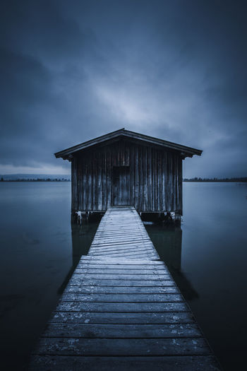 Frosty Jetty Water Architecture Sky Pier No People Tranquility Dusk Jetty Outdoors Beauty In Nature Scenics - Nature Long Exposure Travel Exploring Wanderlust Reflection Blue Hour Fog Mist Moody Weather Winter Frost Frosty Mornings Overcast Leading Lines