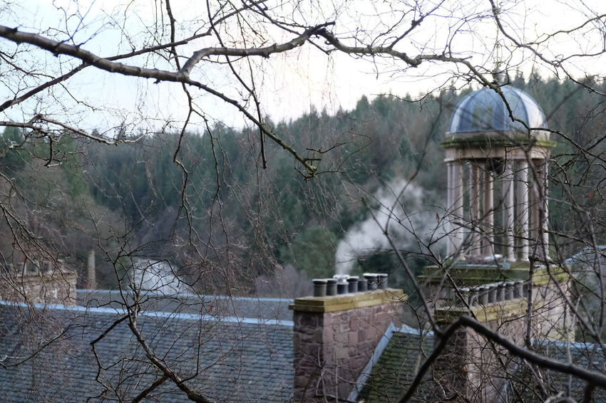 cosy smoking chimneys on a winter walk in New Lanark Architecture Bare Tree Bridge - Man Made Structure Building Exterior Built Structure Chimney Chimney Smoke Day Fog Nature New Lanark No People Outdoors Roof Slates Rooftops Sky Tree Victorian Victorian Architecture Victorian Buildings Water Watermill EyEmNewHere