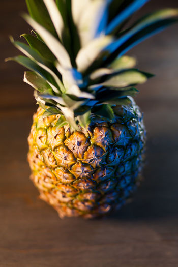 pineapple on wooden table Pineapple Fruit Close-up Nature Healthy Eating Food Wellbeing Freshness Table Wooden Indoors  Tropical Fruit Leaf Vertical Raw Diet Sweet Snack Organic Tasty Juicy Natural Dessert Ripe Vitamin Exotic Yellow Vegan Ingredient Vegetarian Whole Nutrition Antioxidant Delicious Dark Background Board Single Object Eating Green Color Dieting Plant No People Food And Drink