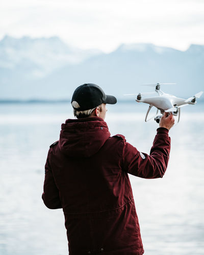 Drone  Dji Phantom Phantom 4 Phantom 4 Pro Phantom 4 Pro Plus Water Real People Sea One Person Standing Activity Holding Waist Up Lifestyles Leisure Activity Scenics - Nature Nature Clothing Mountain Sky Beauty In Nature Day Rear View Outdoors Warm Clothing