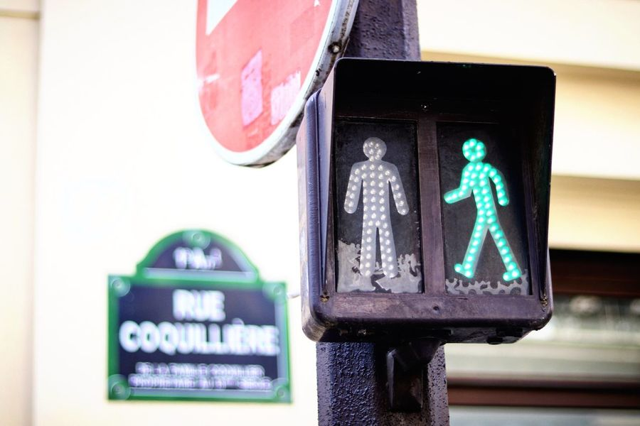 Trafic light in Paris Close-up Europe French France Parisian Life Parisian Street Sign Paris, France  Paris Road Sign Cross Pedestrian Pedestrian Crossing Urban Street Life Street Light Streetphotography Street Trafic Lights Representation Road Sign No People Direction Directional Sign Green Light Green Color Road Signal Day Focus On Foreground Information Sign