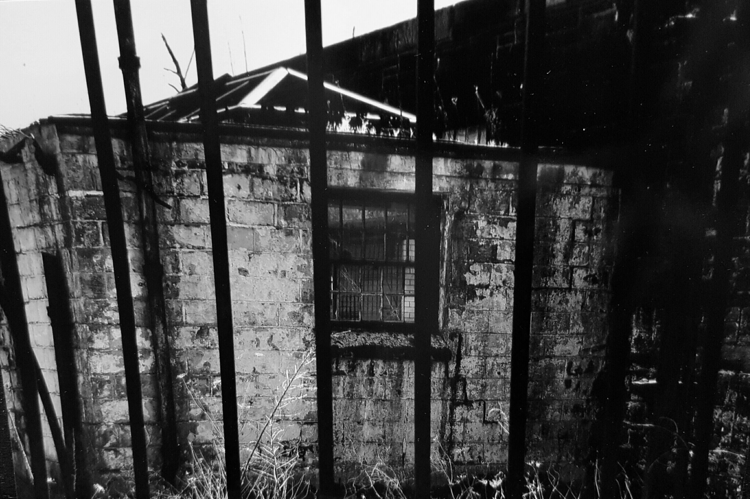 abandoned, built structure, architecture, obsolete, damaged, run-down, deterioration, old, weathered, building exterior, window, bad condition, house, metal, rusty, destruction, broken, wall - building feature, wood - material, low angle view