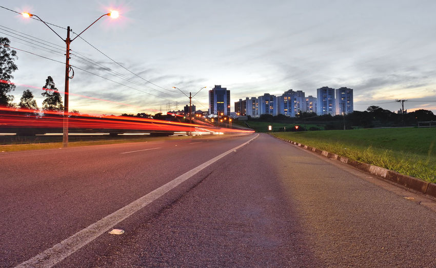 Buildings and car light trails in the access road to Campinas, SP/Brazil Architecture Building Exterior Buildings Built Structure City Cityscape Cloud - Sky Day Light Trail Modern Night Road Sunset Travel Destinations Urban Scene Urban Skyline Mobility In Mega Cities