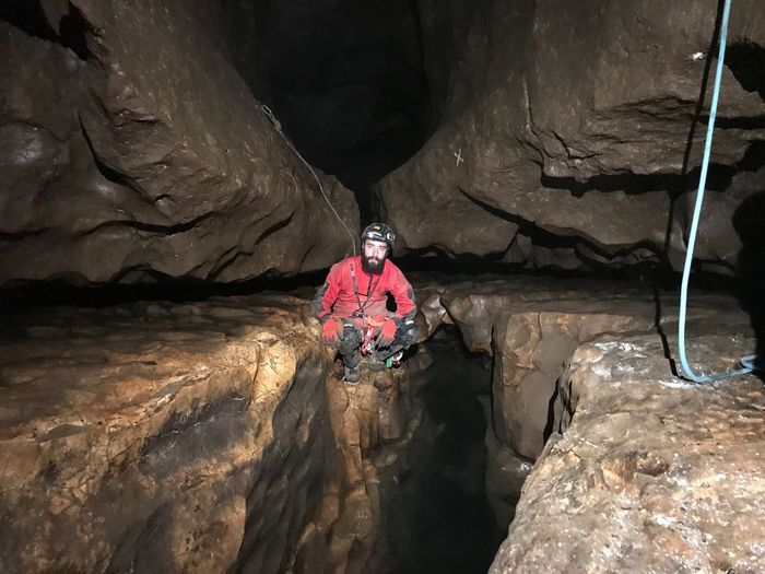 Exploration Caver Speleology Cave Scientist Climbing EyeEm Selects One Person Leisure Activity Real People Nature Front View Water Adventure Adult Lifestyles Full Length Rock Men Rock - Object Solid Sunlight High Angle View Sport Shadow Outdoors Mature Men