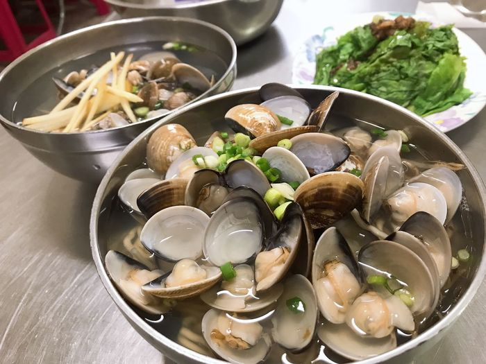 High angle view of mussels in bowls on table