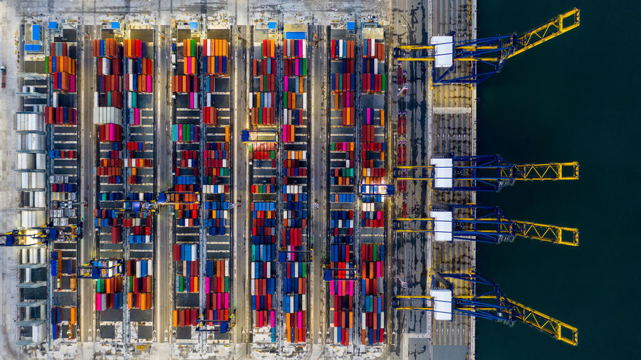 Aerial view commercial sea port warehouse and crane ship, container ship at industrial port