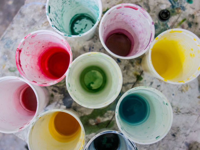 mixing colours in a plastic cup Multi Colored Choice Variation Paint Close-up No People High Angle View Art And Craft Still Life Craft Indoors  Large Group Of Objects Messy Creativity Focus On Foreground Art And Craft Equipment Dirt Day Container Watercolor Paints Mixing Colors Plastic Cups