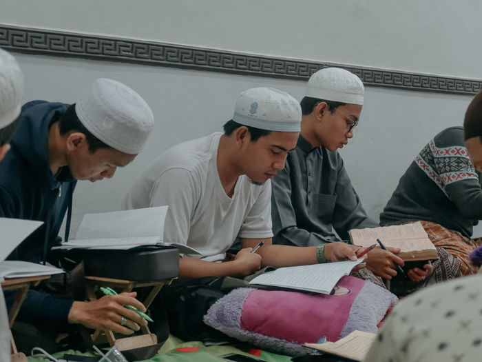 Group of people sitting in book