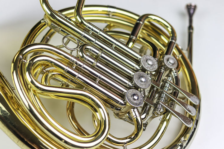 Music Instrument French horn Musical Instrument Metal Studio Shot Music Brass Instrument  Indoors  Arts Culture And Entertainment White Background Close-up Still Life Gold Colored No People Musical Equipment Cut Out Focus On Foreground Wind Instrument Shiny Brass Single Object Yellow