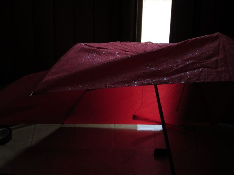 Drying Everyday Objects Half Open Door Light And Shadow No People Red And Black Shadowy Umbrella Wet Day